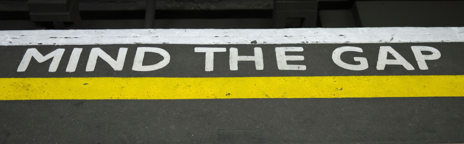 Mind The Gap sign on tube  station platform in London UK